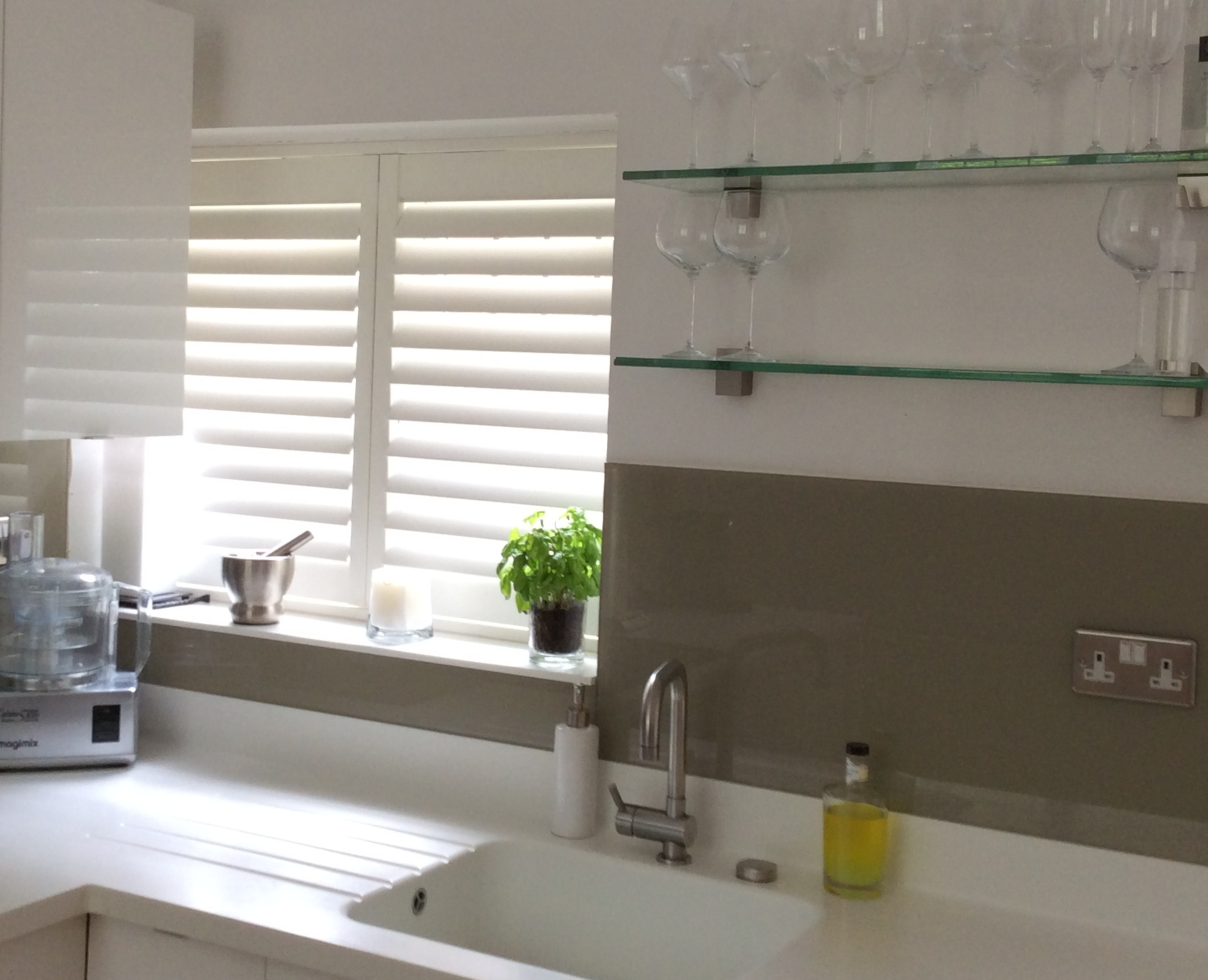 Low cost kitchen shutters give a stylish finish at a great price.
