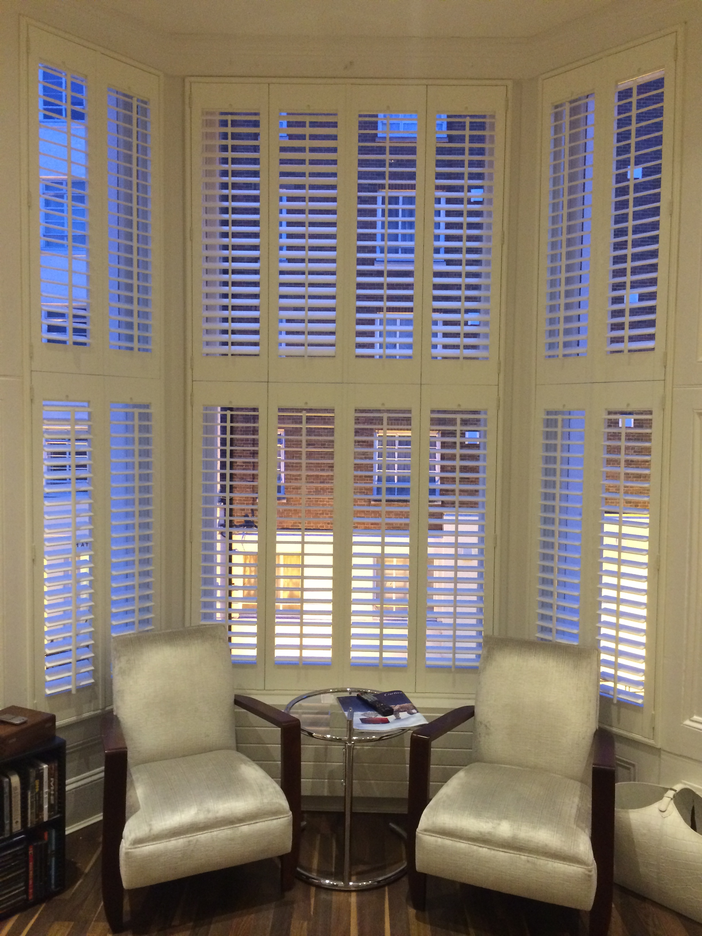 Tier on Tier hardwood shutters with a centre tilt-rod in West London